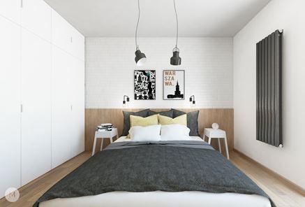 Przytulna sypialnia z białą cegiełka