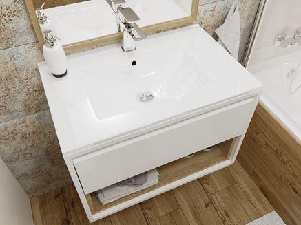 Biała umywalka z podwieszaną szafką
