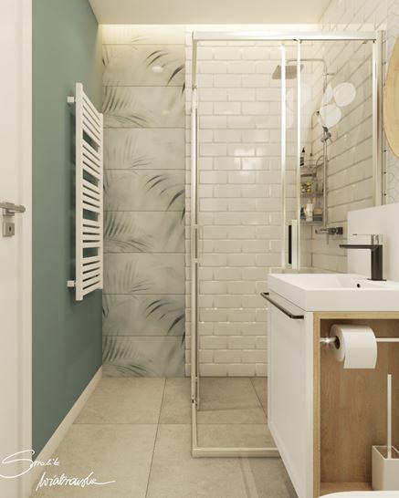 Skandynawska łazienka z dodatkiem zieleni
