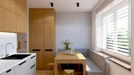 Kącik jadalny przy niewielkiej kuchni z oknem