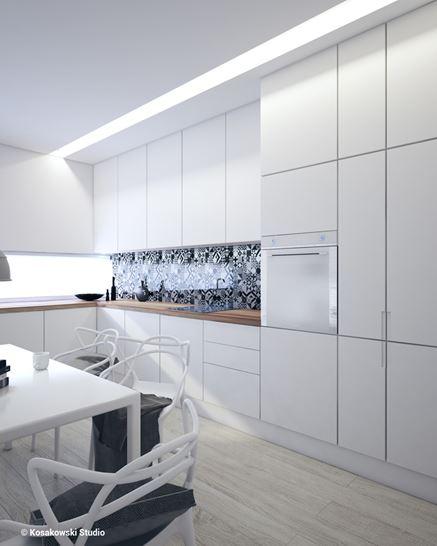 Białe szafki w jasnej kuchni