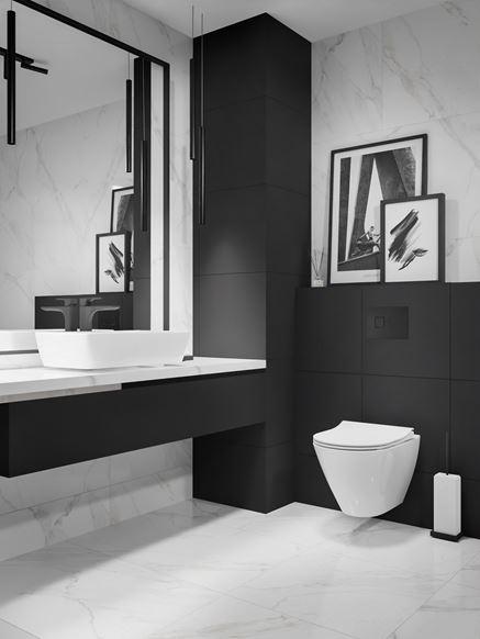 Toaleta w czerni i bieli wykończona marmurem