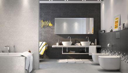 Łazienka w czarno-białych płytkach inspirowanych betonem