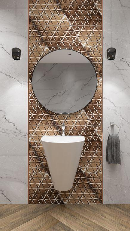 Umywalka otoczona złotą mozaiką