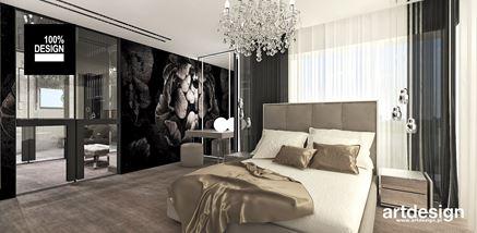 Sypialnia z oryginalną fototapetą w kwiaty