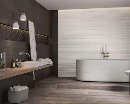Aranżacja łazienki z kamiennymi płytkami w szarości i czerni