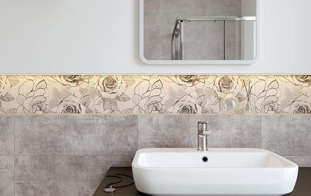 Strefa umywalkowa wykończona szarymi płytkami i dekorami
