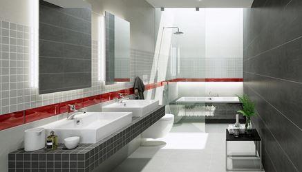 Szara łazienka z mocnym czerwonym akcentem