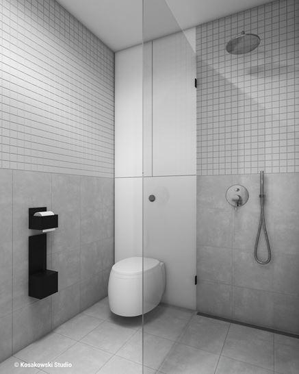 Mała, betonowa łazienka