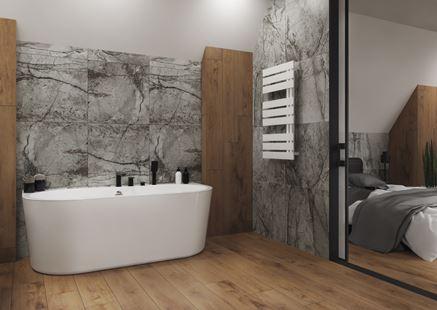 Łazienka z wanną wolnostojącą w kamieniu i drewnie