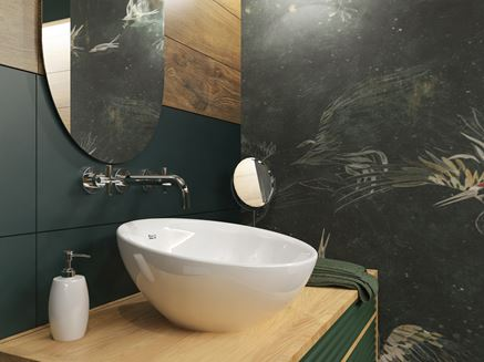 Umywalka nablatowa w zielonej łazience z dekoracyjną ścianą