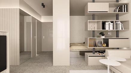 Strefa sypialna za regałem w małym mieszkaniu