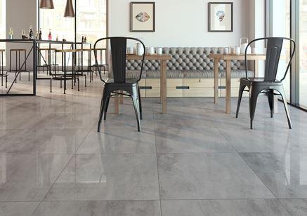 Restauracja z szarą płytką z wzorem betonu