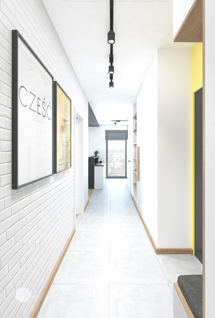 Minigaleria w korytarzu z cegłą