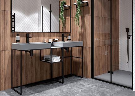 Czarne baterie umywalkowe Deante Anemon Bis w łazience z drewnem