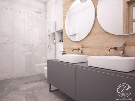 Łazienka z drewnopodobną ścianą przy umywalce