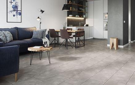 Betonowa podłoga w salonie otwartym na kuchnię Cersanit City Square