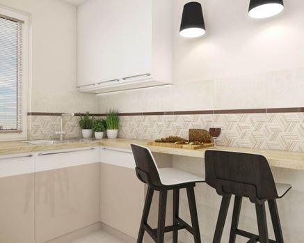 Jasna kuchnia z dekoracyjną ścianą z płytek strukturalnych