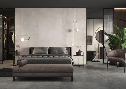 Wielkoformatowy beton w industrialnej sypialni z garderobą