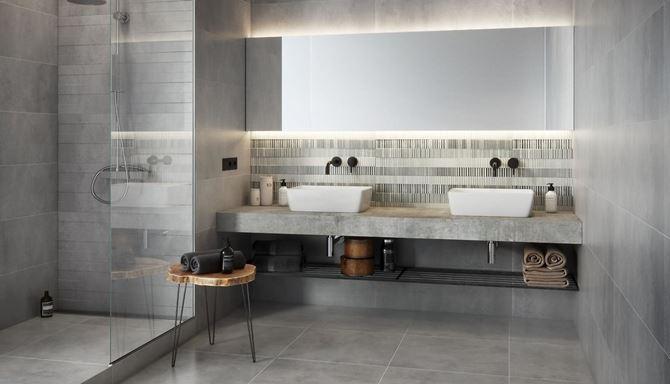 Aranżacja szarej łazienki z dekoracyjną płytką w paski