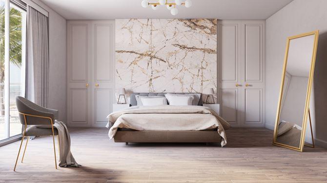 Sypialnia w stylu glamour ze ścianą Azario Gristone