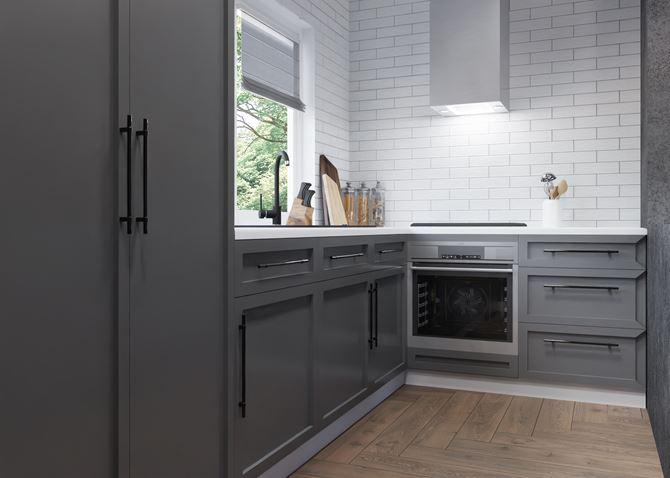 Szara kuchnia z białą cegiełkowaną ścianą
