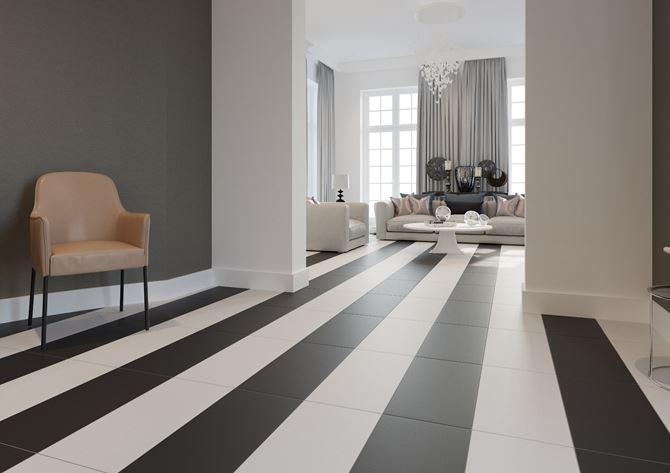Czarno-białe płytki i widok na przestronny salon Cerrad Cambia