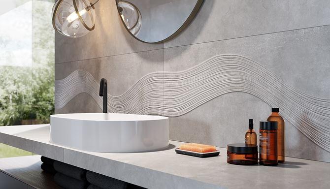 Szary beton i rysunek fal na ścianie w łazience