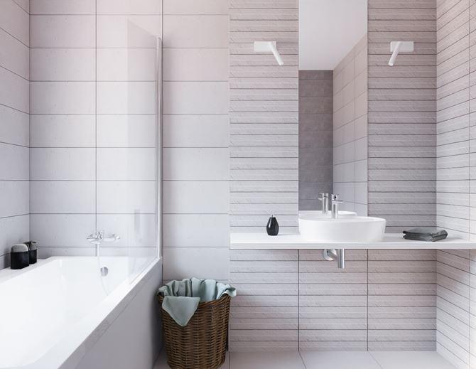 Łazienka w jasnoszarym kolorze z płytkami strukturalnymi
