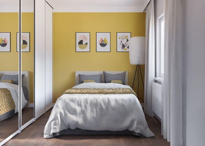 Nieduża sypialnia z żółtą ścianą