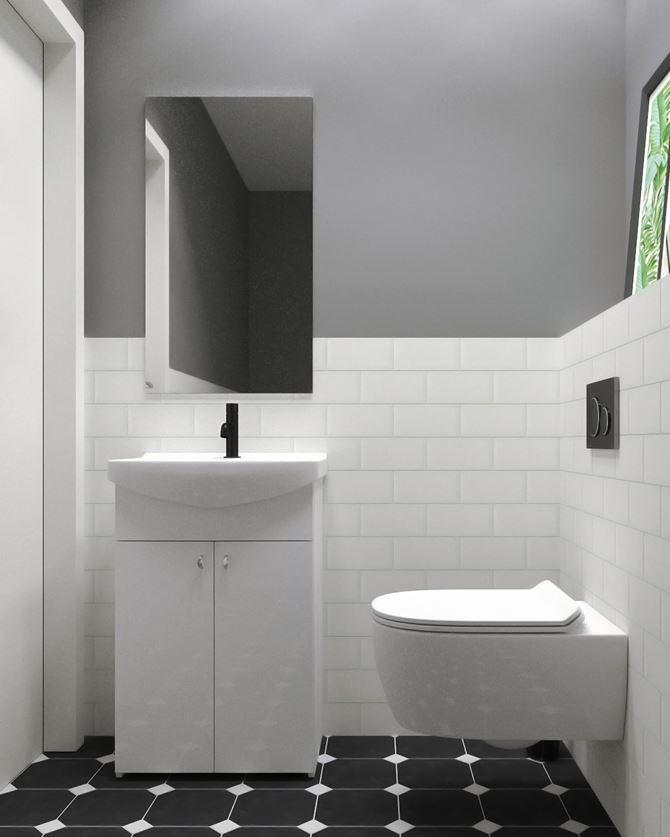 Toaleta z białą, ceglastą ścianą
