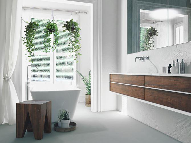Aranżacja salonu kąpielowego z zielenią w oknie