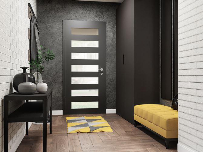 Przedpokój z drewnianą podłogą i cegiełkowaną ścianą