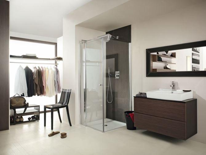 Nowoczesna łazienka z garderobą z linią  Deante Cubic