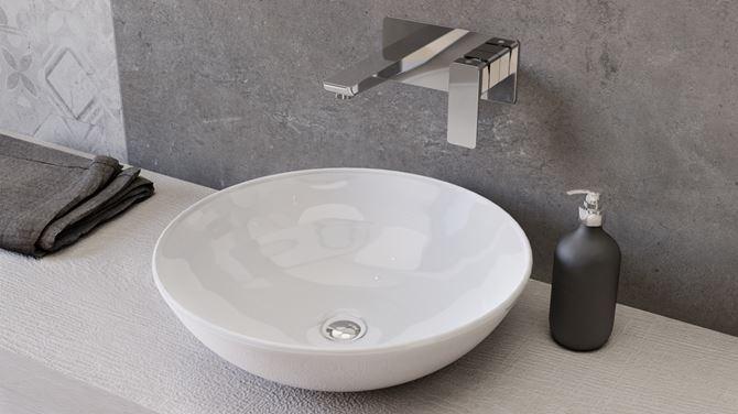 Okrągła umywalka nablatowa w otoczeniu szarości