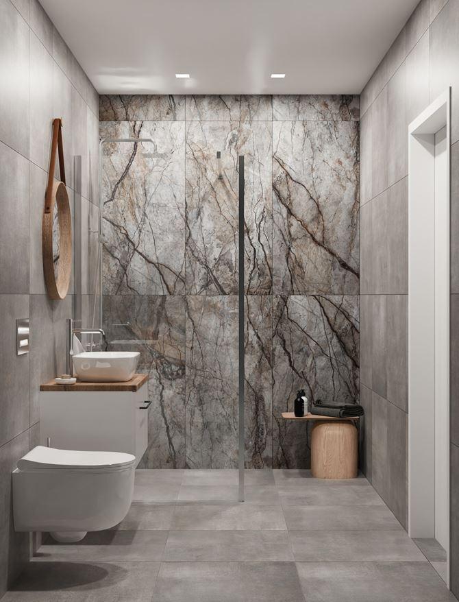 Aranżacja szarej łazienki z dekoracyjną ścianą