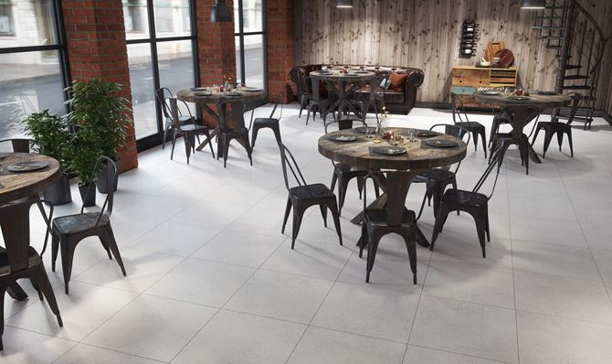 Restauracja w stylu industrialnym z kaflami Domino Otis