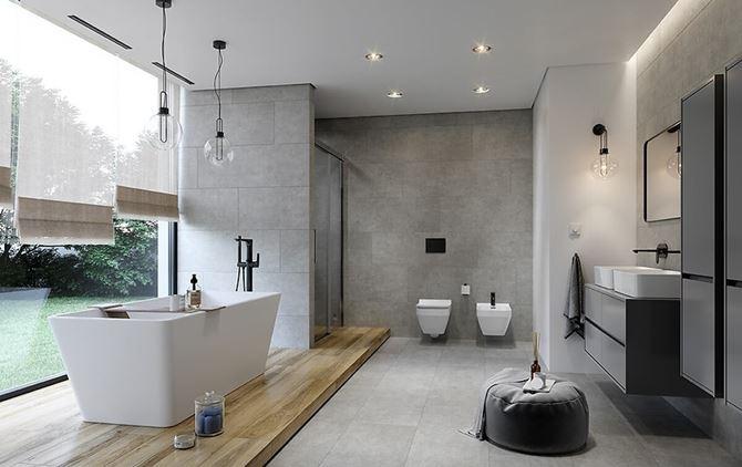 Przestronna łazienka w szarościach z wanną wolnostojącą
