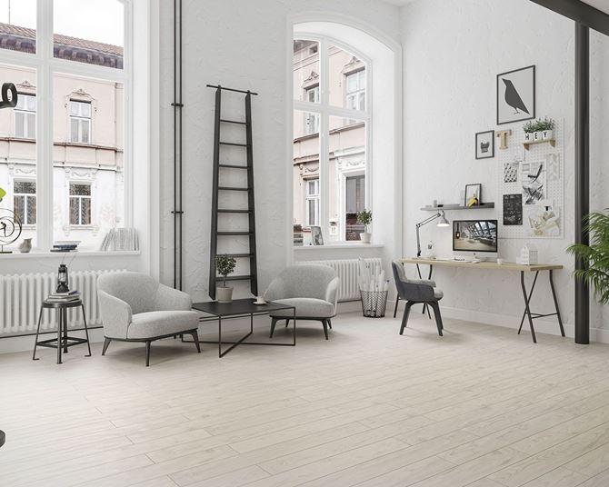 Jasny salon w stylu skandynawskim z drewnopodobną podłogą