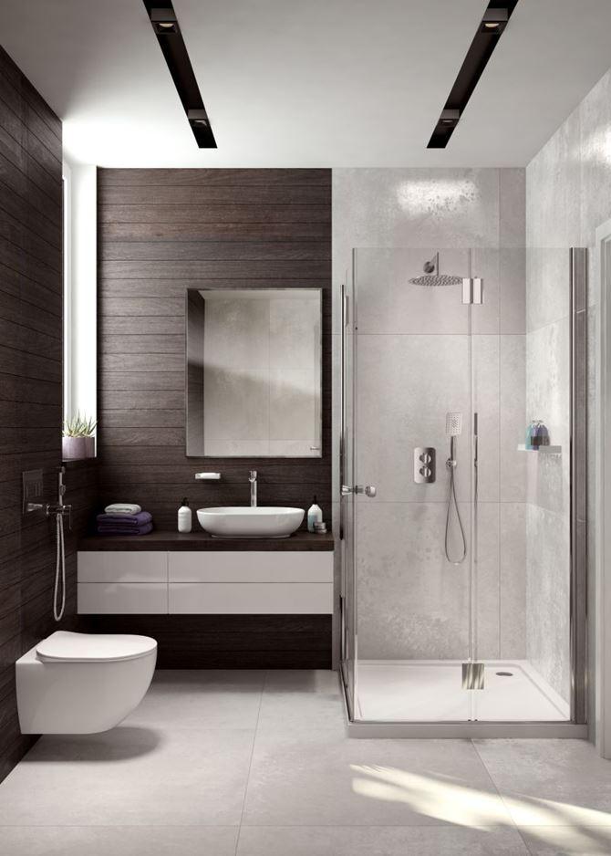 Mała łazienka z prysznicem w ciemnym drewnie i betonie