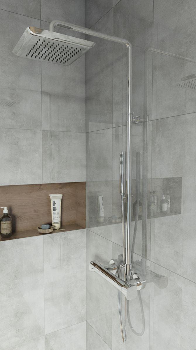 Chromowana bateria prysznicowa i szare płytki ścienne w strefie kąpielowej
