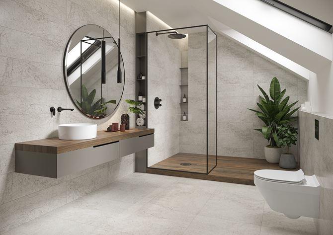 Szara łazienka na poddaszu z kaflami z wzorem kamienia