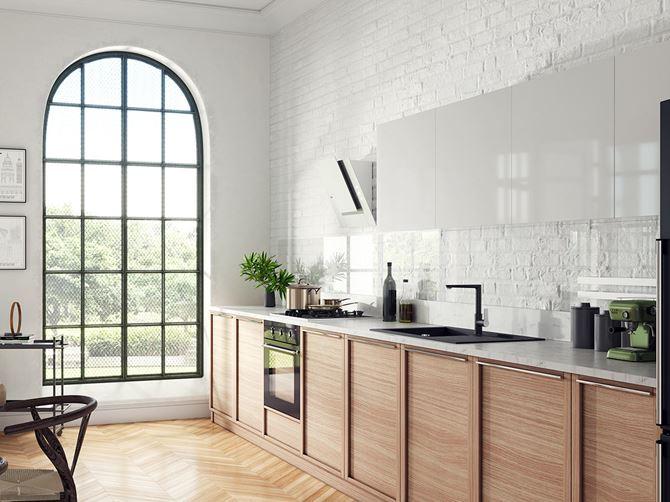 Aranżacja kuchni z ceglastą ścianą i czarnymi dodatkami