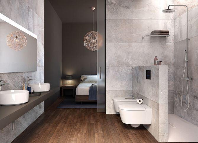 Łazienka przy sypialni wykończona kamiennymi płytami