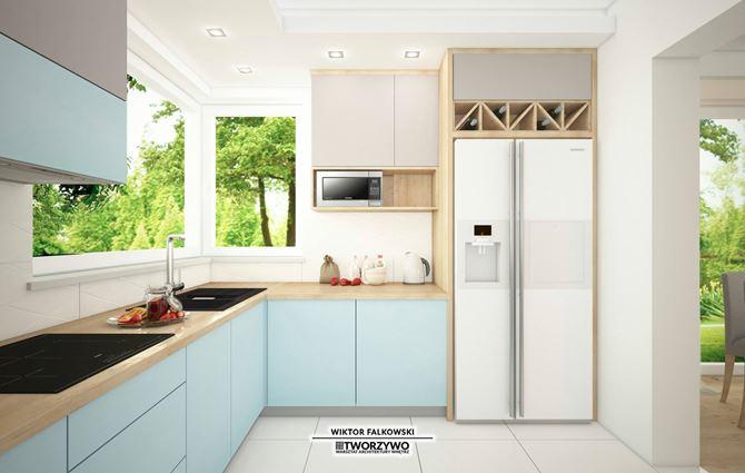 Błękitna zabudowa w zamkniętej kuchni z oknem