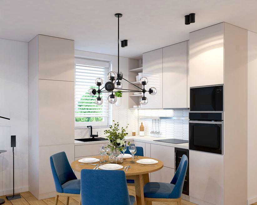 Biały aneks kuchenny i niebieskie krzesła