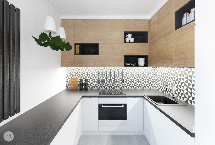 Biała kuchnia z geometrycznymi płytkami nad blatem