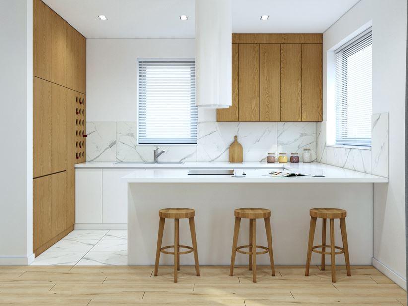 Biała, otwarta kuchnia z oknem w domu