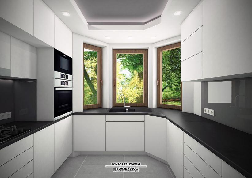 Zlew pod oknem w białej kuchni
