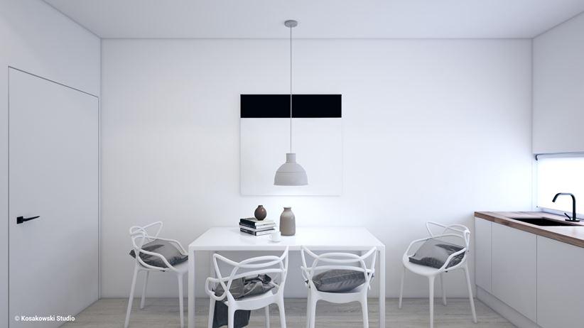 Stół jadalny w białej kuchni